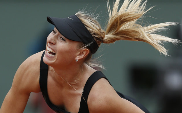 Maria Sharapova of Russia returns in her quarter final match against Kaia Kanepi of Estonia at the French Open tennis tournament in Roland Garros stadium in Paris, Wednesday June 6, 2012. Sharapova won in two sets, 6-2, 6-3. (AP Photo/Bernat Armangue)