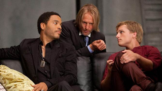 """In this image released by Lionsgate, from left, Lenny Kravitz portrays Cinna, Woody Harrelson portrays Haymitch Abernathy and Josh Hutcherson portrays Peeta Mellark in a scene from """"The Hunger Games."""" (AP Photo/Lionsgate, Murray Close)"""