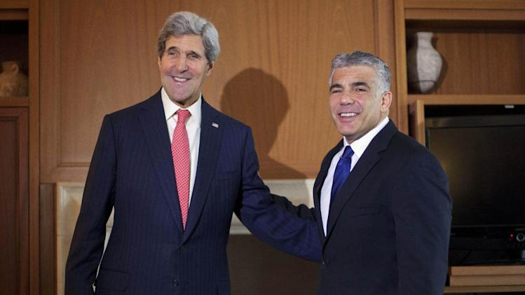 U.S. Secretary of State Kerry smiles with Israel's Finance Minister Lapid before their meeting in Jerusalem