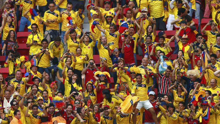 Colombia fans celebrate Juan Quintero's goal during the 2014 World Cup Group C soccer match between Colombia and Ivory Coast at the Brasilia national stadium