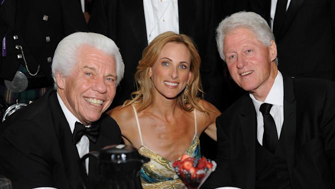 """COMMERCIAL IMAGE - Bill Austin, left,  Marlee Matlin, center, and former President Bill Clinton is seen at the 12th Annual Starkey Hearing Foundation """"So The World May Hear"""" Gala on Saturday, Aug. 4, 2012 in St. Paul, Minn. The foundation conducts dozens of hearing missions every year in the U.S. and around the world and has given the gift of hearing in more than 97 countries. (Photo by Diane Bondareff/Invision for Starkey Hearing Foundation/AP Images)"""