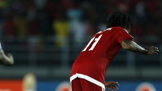 An Equatorial Guinea fan celebrates with Javier Balboa on the pitch after winning their quarter-final soccer match of the 2015 African Cup of Nations against Tunisia in Bata