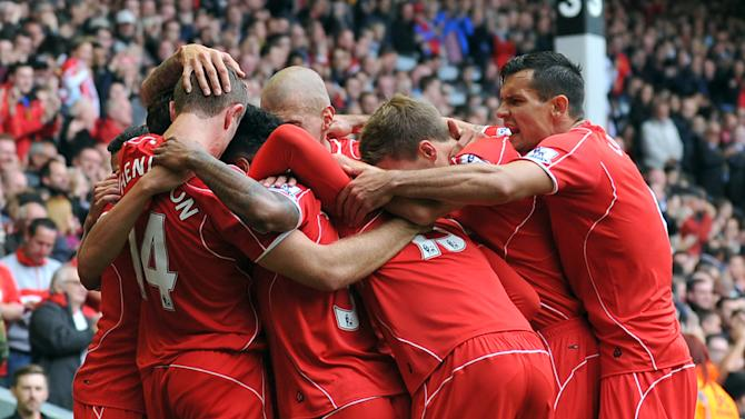 Liverpool players celebrate a goal during a match in Liverpool, England on August 17, 2014