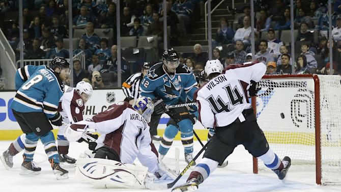 San Jose Sharks center Patrick Marleau (12) scores past Colorado Avalanche goalie Semyon Varlamov (1), of Russia, and defenseman Ryan Wilson (44) during the first period of an NHL hockey game in San Jose, Calif., Saturday, Jan. 26, 2013. (AP Photo/Marcio Jose Sanchez)