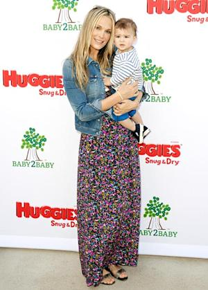 "Molly Sims on Her Post-Baby Style: ""I Have to Force Myself Out of Yoga Clothes!"""