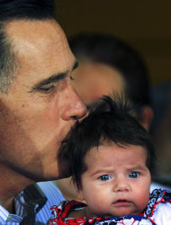 Republican presidential candidate, former Massachusetts Gov. Mitt Romney kisses an unidentified baby as he makes a campaign stop at Thompson Tractor, Friday, March 9, 2012, in Tarrant, Ala., near Birmingham. (AP Photo/The Birmingham News, Hal Yeager) MAGS OUT