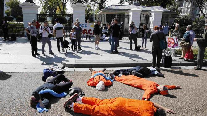Activists from the National Campaign for Nonviolent Resistance lay down on Pennsyvania Ave. in front of the White House in Washington