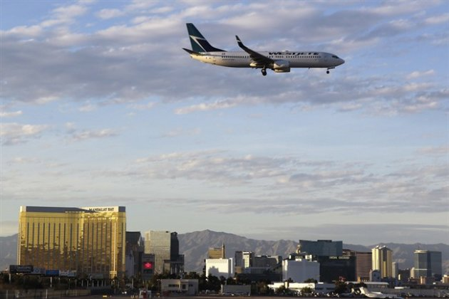 A WestJet Airlines flight prepares to land March 22, 2012, in Las Vegas. THE CANADIAN PRESS/AP, Julie Jacobson