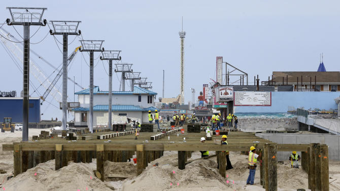 Construction of a new boardwalk continues on the northern end of Seaside Heights, N.J., Saturday, May 18, 2013.  Visitors to the Jersey shore this weekend will find many of their favorite beaches and boardwalks ready for summer, thanks to a massive rebuilding effort after Superstorm Sandy. While several neighborhoods remain damaged, all but one of the storm-wrecked boardwalks should be ready for Memorial Day weekend, and amusement rides will still be available from Keansburg to Wildwood. Most beaches will be open, despite losing sand during the storm. (AP Photo/Mel Evans)