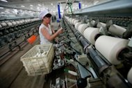 An employee works at a cotton thread factory in Huaibei, in eastern China's Anhui province. China on Thursday cut interest rates for the first time in over three years and moved to allow rates to float more freely, in a bid to boost a slowing economy and advance financial reform