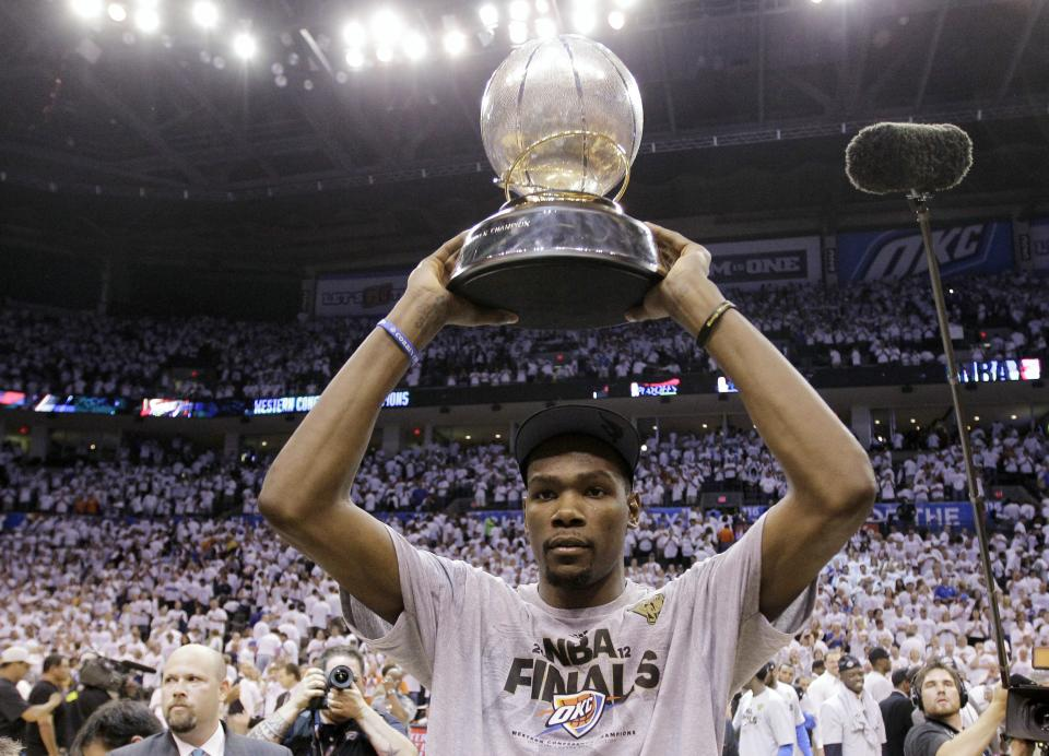 Oklahoma City Thunder small forward Kevin Durant holds the western conference trophy after Game 6 in the NBA basketball Western Conference finals against the San Antonio Spurs, Wednesday, June 6, 2012, in Oklahoma City. The Thunder won 107-99 and move on to the NBA Finals. (AP Photo/Eric Gay)
