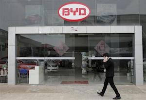 A man walks past a BYD store in Wuhan
