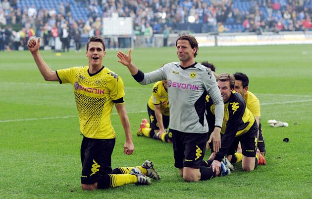 TOPSHOTS Dortmund's Players Celebrate    +++ RESTRICTIONS / EMBARGO - DFL LIMITS THE USE OF IMAGES ON THE INTERNET TO AFP/Getty Images