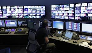 """A technician works in the """"Acquisition Room"""", which receives televison feeds from around the world, during an event to mark the opening of the new Univision and Fusion television networks newsroom in Doral"""