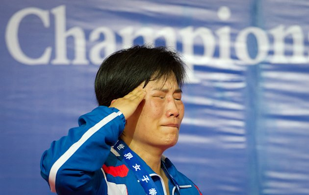 Gold Medallist Pak Kyong Of North Korea Salutes AFP/Getty Images