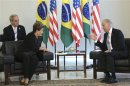 U.S. VP Biden speaks to Brazil's President Rousseff during a meeting on his visit to Brazil