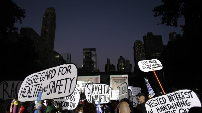 Occupy Wall Street protesters hold up placards in Bryant Park in New York