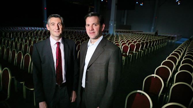 IMAGE DISTRIBUTED FOR AMAZON WEB SERVICES - Ronan Kneafsey, managing director of eircom Business, left, and Terry Wise, Director of Worldwide Partnerships, Amazon Web Services, stand in a keynote hall at Amazon Web Services' inaugural re: Invent conference on Tuesday, Nov. 27, 2012, in Las Vegas. The companies announce the start of their relationship where eircom, Ireland's largest telecommunications company, will offer cloud technology services to businesses in Ireland and the United Kingdom, which is based upon Amazon Web Services technology.  (Ronda Churchill/AP Images for Amazon Web Services)