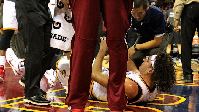Anderson Varejao of the Cleveland Cavaliers lies on the court after suffering an injury in a game against the Minnesota Timberwolves in Cleveland, Ohio, on December 23, 2014