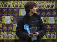 A Conservative supporter stands outside the UKIP (UK Independence Party) offices in Eastleigh, southern England February 28, 2013. REUTERS/Luke MacGregor