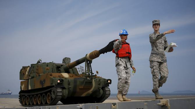 A South Korean army's K-55 self-propelled artillery vehicle travels along a floating dock during the Combined Joint Logistics Over The Shore (CJLOTS) exercise, at a seashore in Taean