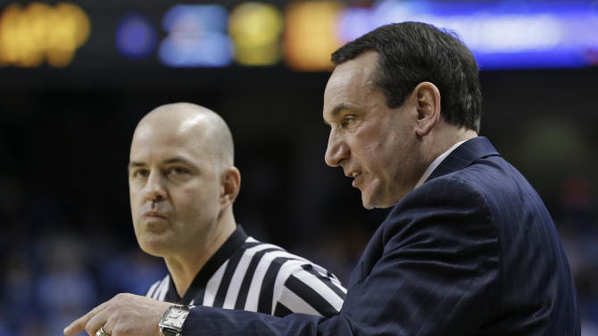 Duke coach Mike Krzyzewski, right, argues a call with a referee during the first half of an NCAA college basketball game against Maryland at the Atlantic Coast Conference men's tournament in Greensboro, N.C., Friday, March 15, 2013. (AP Photo/Gerry Broome)