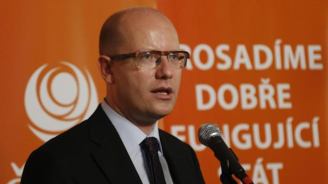 Social Democratic chairman Bohuslav Sobotka addresses media as the polling station for the early general elections close in Prague, Czech Republic, Saturday, Oct. 26, 2013. Words in background read: We will enforce a well functioning state. (AP Photo/Petr David Josek)
