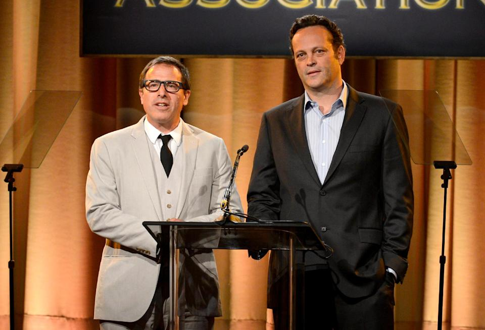 David O. Russell, left, and Vince Vaughn speak on stage at the Hollywood Foreign Press Association Luncheon at the Beverly Hilton Hotel on Tuesday, Aug. 13, 2013, in Beverly Hills, Calif. (Photo by Chris Pizzello/Invision/AP)