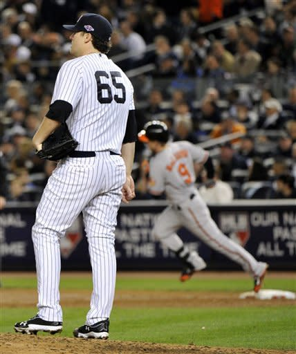 Yankees, O's tied 1-all after 12th in Game 4