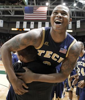 Georgia Tech's Marcus Georges-Hunt (3) celebrates after Georgia Tech defeated Miami 71-69 in an NCAA college basketball game in Coral Gables, Fla., Wednesday,  March 6, 2013. Georgia Tech won 71-69. (AP Photo/Luis M. Alvarez)