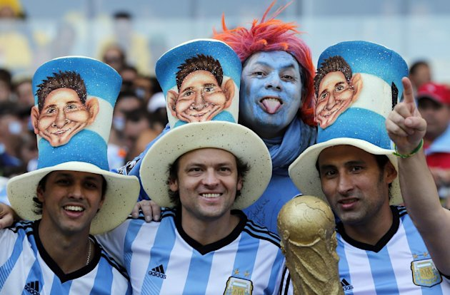 Argentina supporters wear hats bearing the image of Lionel Messi. (AP Photo/Jon Super)