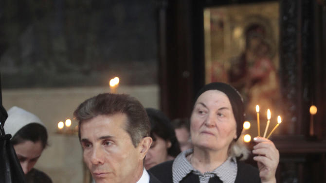 Georgia's billionaire and opposition leader Bidzina Ivanishvili prays in a church in Tbilisi, Georgia, Monday, Oct. 1, 2012.  Voters in Georgia are choosing a new parliament in a heated election Monday that will decide the future of Saakashvili's government. (AP Photo/Georgy Abdaladze)