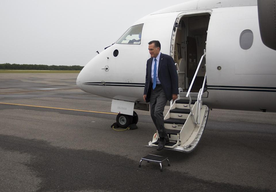 Republican presidential candidate, former Massachusetts Gov. Mitt Romney arrives at Martha's Vineyard airport for fundraising events on Saturday, Aug. 18, 2012 in West Tisbury, Mass.  (AP Photo/Evan Vucci)