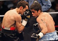 French Brahim Asloum fights against Argentinian Juan Carlos Reveco (right) during a match for the WBA World champion title in the category light flyweight in Le Cannet, southern France on 08 December 2007. Japan&#39;s Masayuki Kuroda will challenge Reveco next month