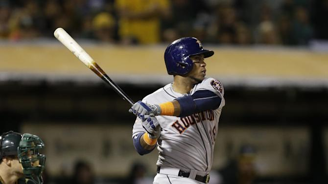 Houston Astros' Luis Valbuena swings against the Oakland Athletics in the seventh inning of a baseball game Friday, April 24, 2015, in Oakland, Calif. (AP Photo/Ben Margot)