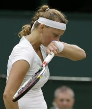 Petra Kvitova of the Czech Republic reacts during a quarterfinals match against Serena Williams of the United States at the All England Lawn Tennis Championships at Wimbledon, England, Tuesday, July 3, 2012. (AP Photo/Anja Niedringhaus)