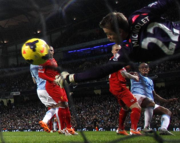 Manchester City's Kompany scores a goal against Liverpool during their English Premier League soccer match in Manchester