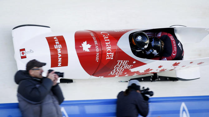 Canada's Kaillie Humphries and Kate O'Brien compete in the women's World Cup bobsled event in Calgary, Saturday, Dec. 20, 2014. (AP Photo/The Canadian Press, Jeff McIntosh)