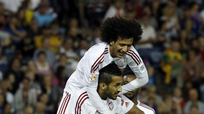 UAE's Ali Mabkhout celebrates his goal with teammate Omar Abdulrahman during their Asian Cup third-place playoff soccer match against Iraq at the Newcastle Stadium in Newcastle