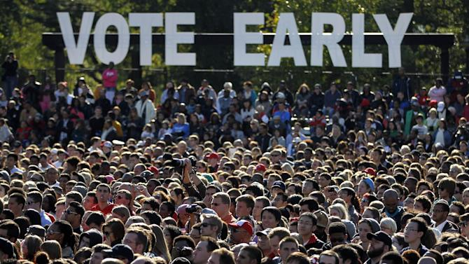 Supporters wait for President Barack Obama to speak during a campaign event at The Ohio State University Oval Tuesday, Oct. 9, 2012, in Columbus, Ohio. (AP Photo/Tony Dejak)