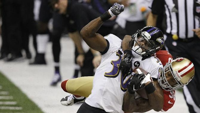 FILE - In this Feb. 3, 2013 file photo, San Francisco 49ers safety Dashon Goldson (38) tackles Baltimore Ravens running back Bernard Pierce (30) during the second half of the NFL Super Bowl XLVII football game in New Orleans. A person with knowledge of the contract says free agent Goldson has agreed to a $41.25 million, five-year deal with the Tampa Bay Buccaneers. The person spoke on condition of anonymity to The Associated Press on Wednesday, March 13, 2013, because the team had yet to formally announce Goldson's deal. (AP Photo/Elaine Thompson, File)