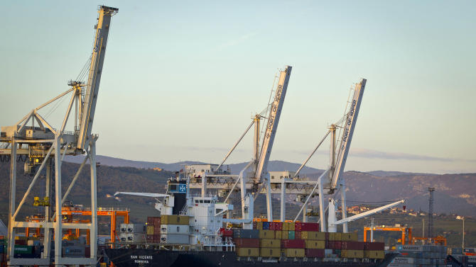"Cranes and a cargo ship are seen in the port of Koper, Slovenia, Tuesday, Sept. 25, 2012. Once the envy of the former European communist states because of its booming economy and Western-style living standards, Slovenia is becoming a showcase of failed transition, government mismanagement and bad loans. Andrej Plut has always thought he was fortunate to live in Slovenia, at one time the most prosperous of the former republics of Yugoslavia and a star among the eastern European states that joined the EU after the fall of communism. The 55-year-old dentist can't figure out what went wrong with his tiny Alpine state, which now faces one of the worst recessions and financial system collapses among the crisis-stricken 17-country group that uses the euro. ""We used to live so well,"" Plut said. ""Now, we don't know what tomorrow brings."" (AP Photo/Darko Bandic)"