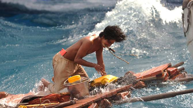 """This publicity photo released by 20th Century Fox shows Suraj Sharma as Pi Patel battling the forces of nature at sea in a scene from the film, """"Life of Pi."""" The film is based on the best-selling novel by Canadian author Yann Martel, a globe-trotting writer born in Spain. (AP Photo/20th Century Fox, Peter Sorel)"""