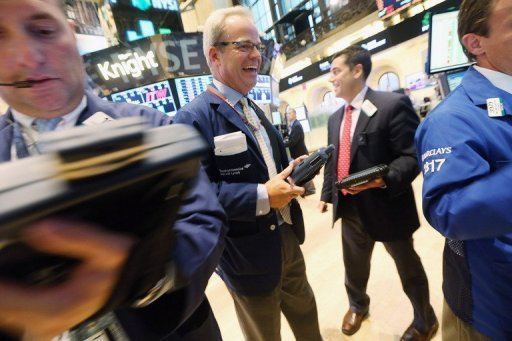 <p>Traders work on the floor of the New York Stock Exchange during afternoon trading on September 14. US stocks sank Wednesday following the paths of markets in Asia and Europe amid a rise in turmoil in the eurozone.</p>