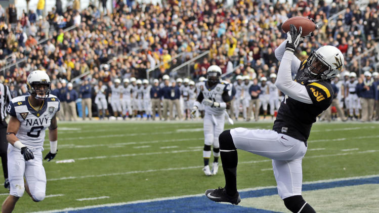 Arizona State wide receiver Alonzo Agwuenu, right, catches an 11-yard touchdown pass near Navy safety Wave Ryder (8) during the first half of the Fight Hunger Bowl NCAA college football game in San Francisco, Saturday, Dec. 29, 2012. (AP Photo/Marcio Jose Sanchez)