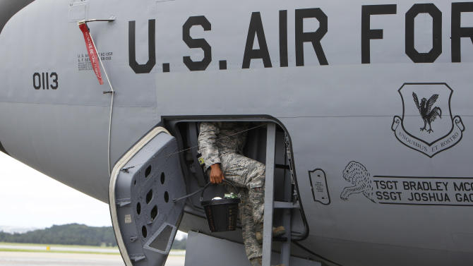 In this Aug. 14, 2012 photo, a ground crew member climbs down the ladder of a U.S. Air Force KC-135 Stratotanker, which was built in 1958, at Kadena Air Base on Japan's southwestern island of Okinawa.  For decades, the U.S. Air Force has grown accustomed to such superlatives as unrivaled and unbeatable. Now some of its key aircraft are being described with terms like decrepit.  (AP Photo/Greg Baker)