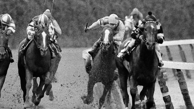FILE - In this June 9, 1979, file photo, Coastal and jockey Ruben Hernandez, second from right, make the move to pass Spectacular Bid (5) and jockey Ron Franklin on the final turn during the Belmont Stakes horse race at Belmont Park in Elmont, N.Y. Spectacular Bid stepped on a safety pin in his stall the morning of the race and would later fade in the stretch under Franklin to finish in third. As I'll Have Another prepares to attempt to win the Belmont Stakes in his quest to become the 12th Triple Crown champion and first in 34 years on Saturday, June 9, 2012, The Associated Press takes a look at some of the 19 horses who won the Kentucky Derby and the Preakness, but came up short in the final leg of the Triple Crown, and how the race unfolded. (AP Photo/Ron Frehm, File)