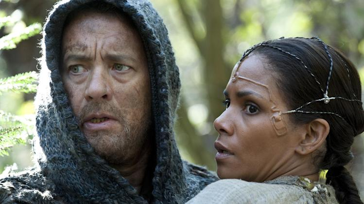 "This film image released by Warner Bros. Pictures shows Tom Hanks as Zachry and Halle Berry as Meronym in a scene from ""Cloud Atlas,"" an epic spanning centuries and genres. (AP Photo/Warner Bros. Pictures, Jay Maidment)"