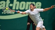 Tommy Haas of Germany returns a ball to Switzerland's Roger Federer during their final match at the ATP Gerry Weber Open tennis tournament in Halle. Haas defeated Federer 7-6 (7/5), 6-4 to win the ATP grasscourt tournament