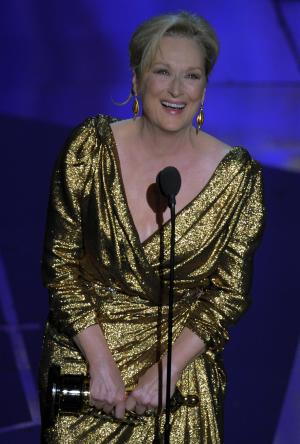 """Meryl Streep accepts the Oscar for best actress in a leading role for """"The Iron Lady"""" during the 84th Academy Awards on Sunday, Feb. 26, 2012, in the Hollywood section of Los Angeles. (AP Photo/Mark J. Terrill)"""